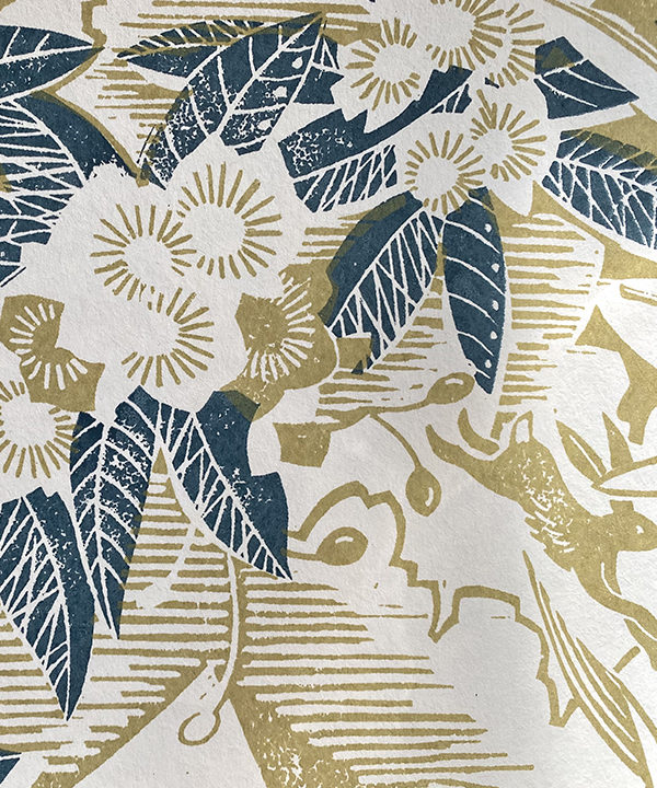 Botanical wallpaper detail in blue and chartreuse.