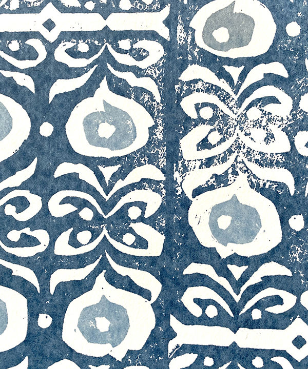 Detail of an indigo-hued, dark blue wallpaper with a Middle Eastern-inspired pattern.