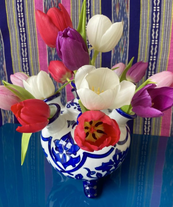 Blue and white small vase from Holland with Spring tulip display.