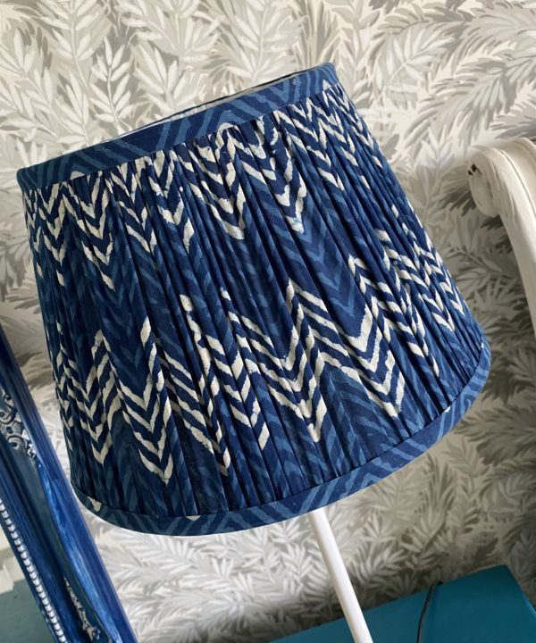 Detail of an indigo blue lampshade in a zig-zag pattern.